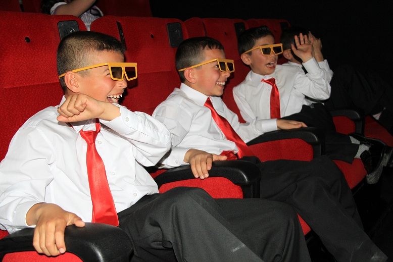 kids watching a movie with 3d glasses